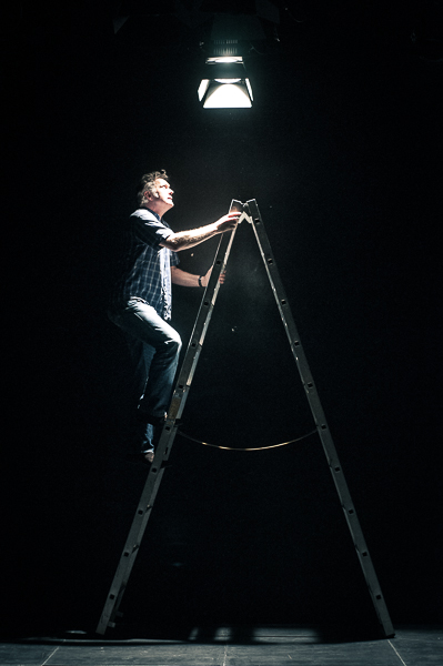 Technician setting up the lights on a ladder